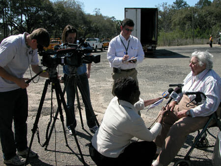 Miss Kate talking to the media before the 2007 Kate Ireland Parkway burn