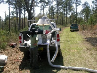 Glynnis Bugna of Florida A & M University measures smoke emissions from a prescribed fire