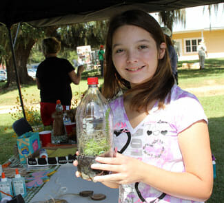 Girl with terrarium she planted.