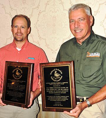 Theron Terhune and Reggie Thackson with Group Achievement Award