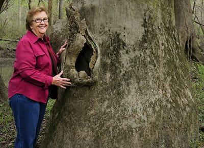 Woman next to a tree